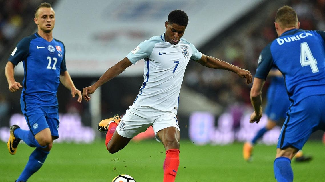 England's striker Marcus Rashford shoots to score England's second goal during the World Cup 2018 qualification football match between England and Slovakia at Wembley Stadium in London on September 4, 2017. (AFP)