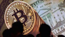 Bitcoin hits new record high of $11,850