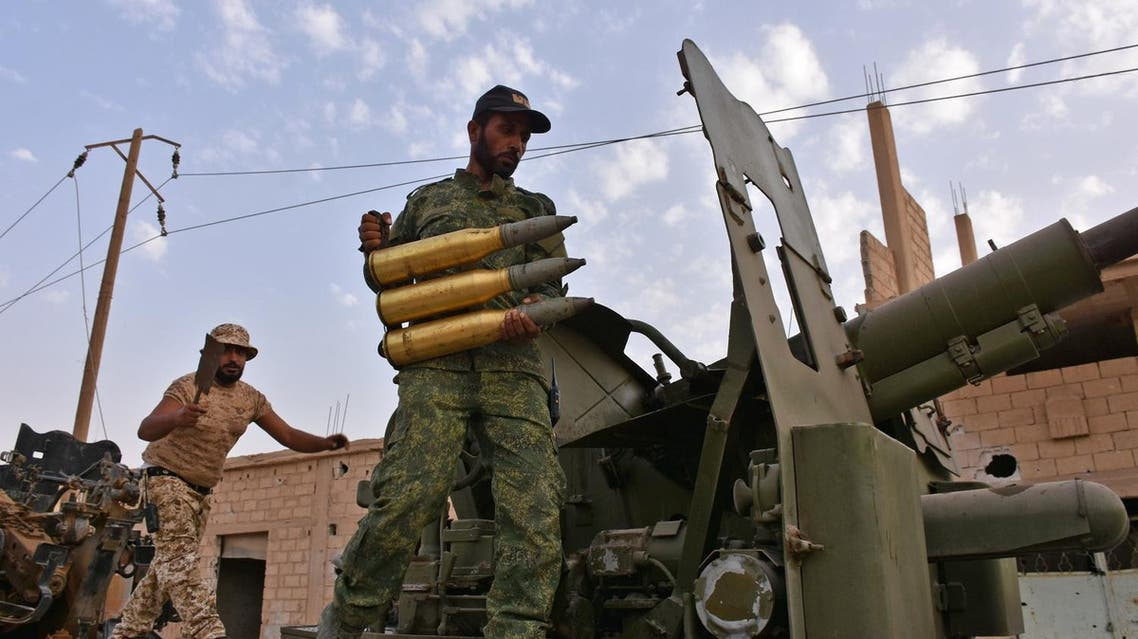 Syrian government forces prepare to fire artillery shells in the area of Kobajjep some 40 kilometres west of Deir Ezzor in the ongoing battle against Islamic State (IS) group jihadists on September 5, 2017. Syria's army broke a years-long Islamic State group siege on the government enclave of Deir Ezzor city as it battles to expel the jihadists from a key stronghold. (AFP)