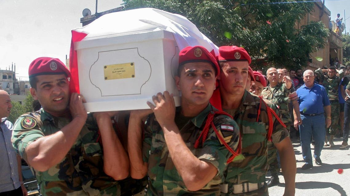 Lebanese soldiers carry the coffin of Walid Freij, a comrade who died in battles against the Islamic State (IS) group along the border with Syria, during his funeral in the town of Saadnayel in the eastern Bekaa valley on August 23, 2017. The army began its campaign in the Jurud Ras Baalbek and Jurud al-Qaa areas on Lebanon's eastern border on August 19, capturing more than two thirds of the 120 square kilometres held by IS jihadists in the first two days. (AFP)