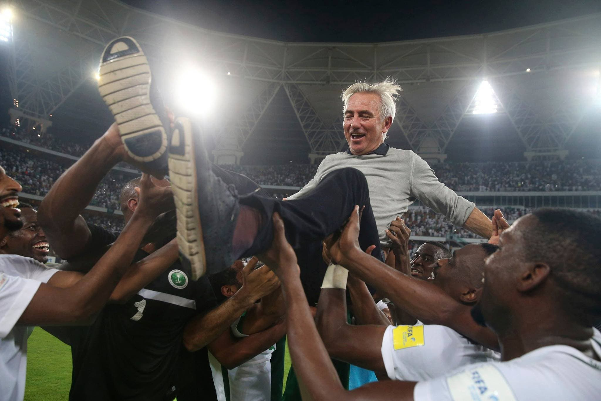 Saudi Arabia's head coach Bert van Marwijk is thrown into the air by his players after winning the 2018 World Cup group B qualifying soccer match between Saudi Arabia and Japan in Jiddah, Saudi Arabia, Tuesday, Sept. 5, 2017. Saudi Arabia won 1-0. (AP)