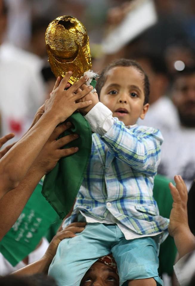 Saudi Arabia's fans cheer during the FIFA World Cup 2018 qualification football match. (AFP)
