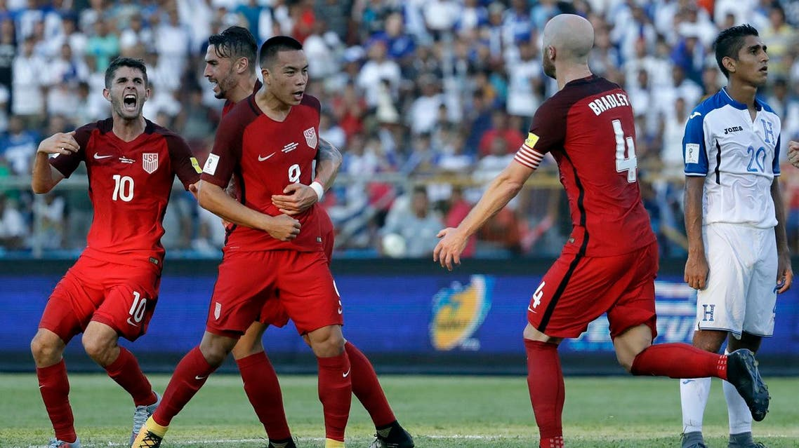 United States' Bobby Wood, 9, celebrates with teammates after scoring his team's first goal during a 2018 World Cup qualifying soccer match against Honduras in San Pedro Sula, Honduras, Tuesday, Sept. 5, 2017. (AP)
