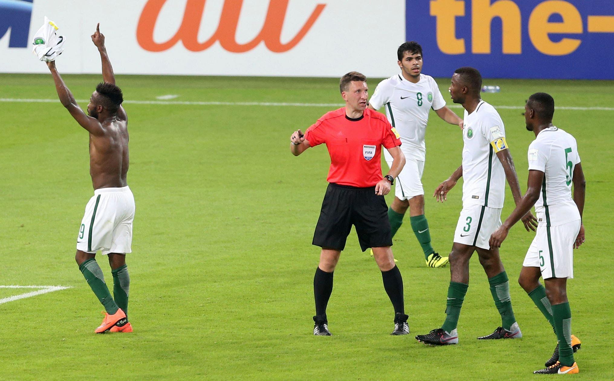 Saudi Arabia's Fhad Al Muwallad, left, celebrates with his teammates scores his side's opening goal. (AP)