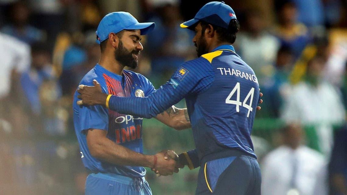 India's captain Virat Kohli shakes hands with Sri Lanka's captain Upul Tharanga after winning the match against them. (Reuters)