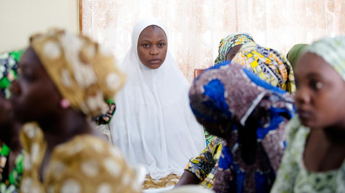 This handout photo released on May 30, 2017 by PGDBA & HND Mass Communication shows newly-rescued Chibok school girls waiting upon their arrival for rehabilitation at the Women Development Centre in Abuja. (AFP)