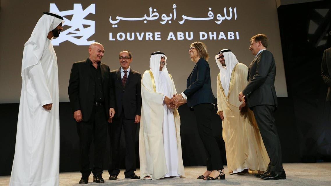 Sheikh Nahyan bin Mubarak, UAE Minister of Culture, shakes hands with Francoise Nyssen, French Minister of Culture, after announcing the opening date of Louvre Abu Dhabi in Abu Dhabi, UAE, on September 6, 2017. (Reuters)