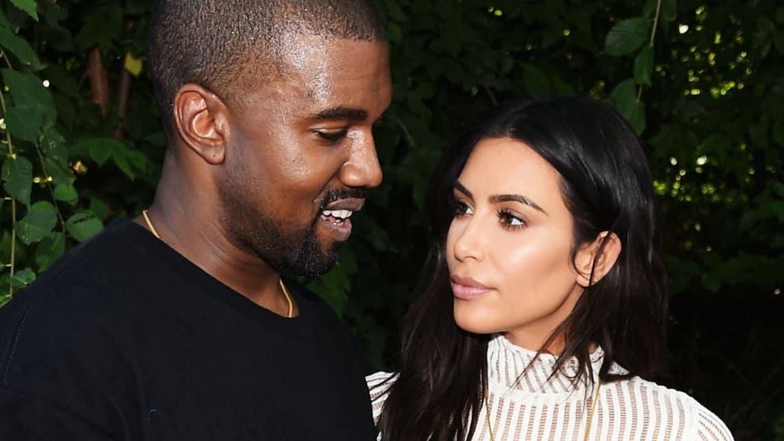 Kanye West and Kim Kardashian attend the Kanye West AFP