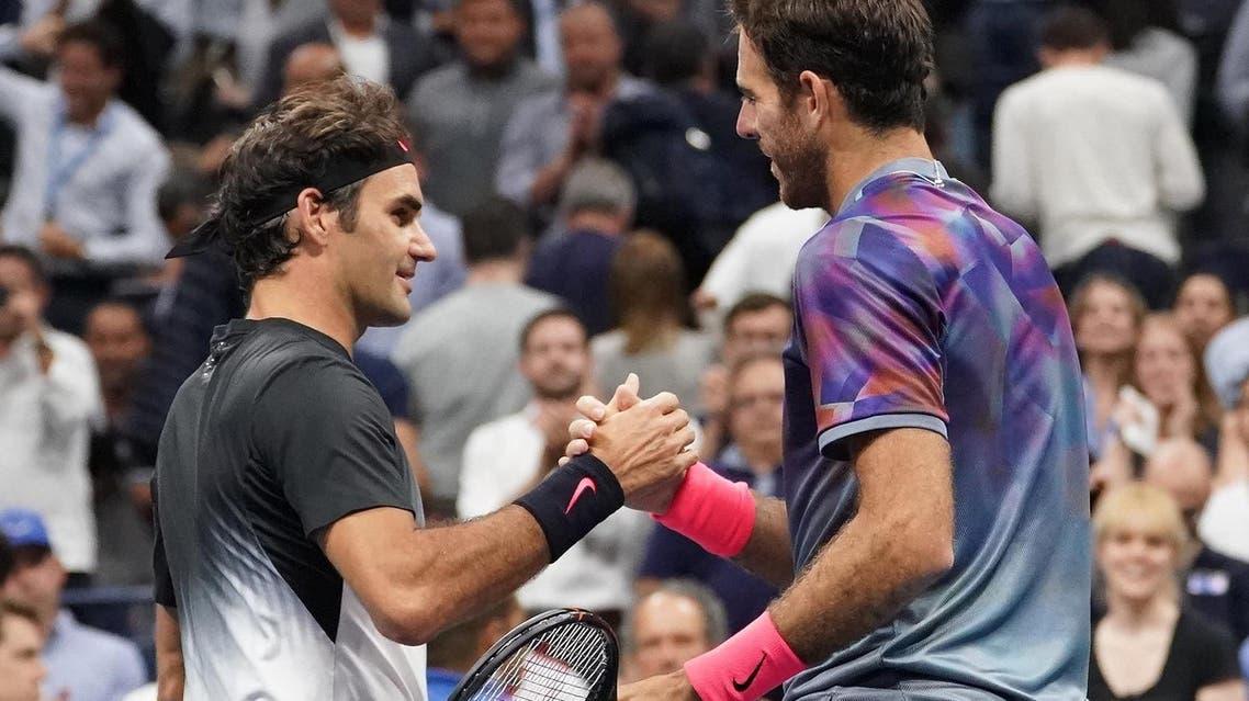 Roger Federer (left) greets Juan Martin del Potro after their US Open tennis match. (Robert Deutsch-USA TODAY Sports/Reuters)