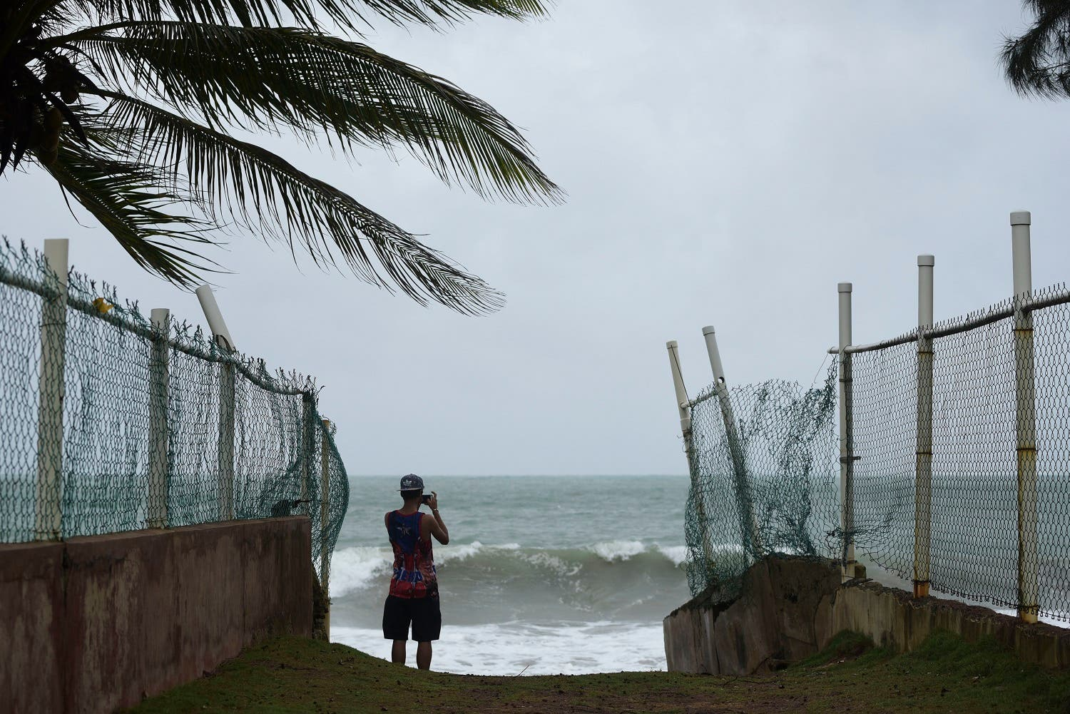A man photographs the ocean before the arrival of Hurricane Irma, in luquillo, Puerto Rico, on Sept. 6, 2017. (AP)