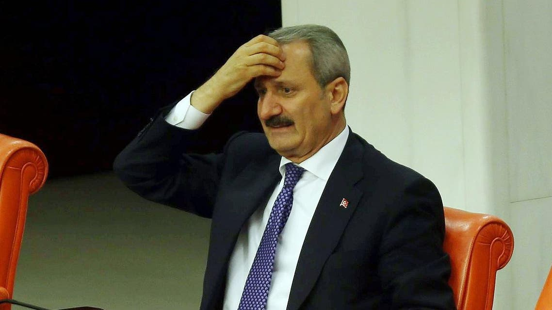 Former Economy Minister Zafer Caglayan takes part in a debate focused on corruption charges against four cabinet ministers of Turkish Prime Minister, at the parliament in Ankara, on May 5, 2014. (AFP)