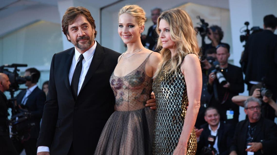 """Spanish actor Javier Bardem, US actress Jennifer Lawrence (C) and US actress Michelle Pfeiffer attend the premiere of the movie """"Mother!"""" at 74th Venice Film Festival on September 5, 2017. (AFP)"""