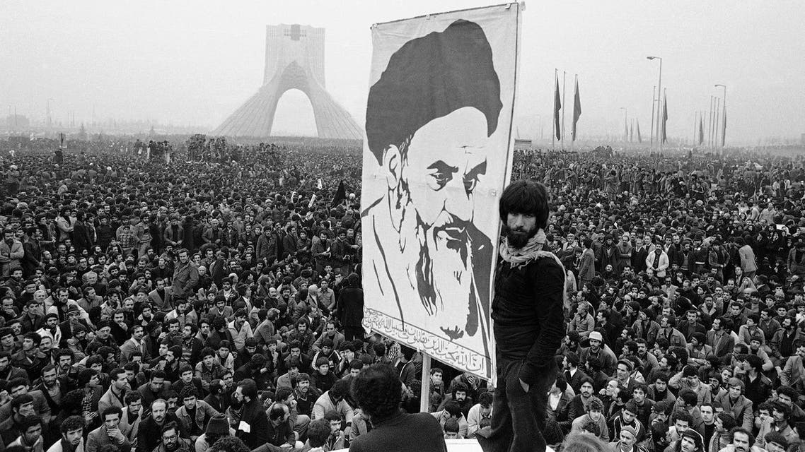 In this Dec. 10, 1978 file picture, demonstrators hold up a poster of exiled Muslim leader Ayatollah Khomeini during an anti-shah demonstration in Tehran at the Shayah monument, which was built to commemorate the monarch's rule and symbol of his power. (AP)