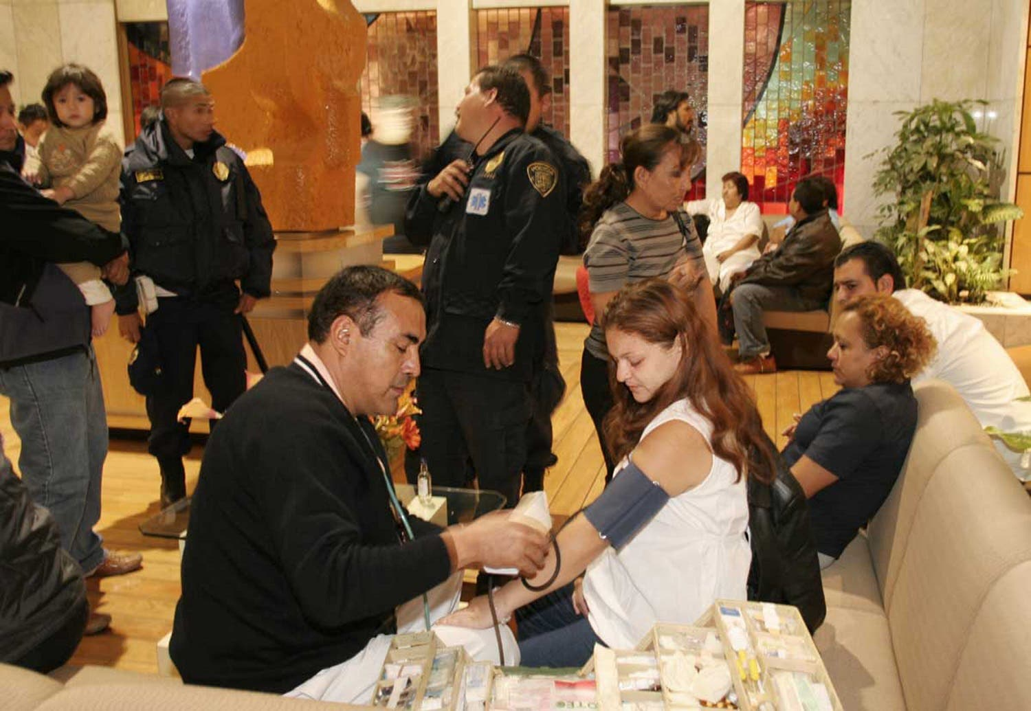 A woman is attended by a paramedic in the lobby of her hotel following a 5.4 magnitude earthquake in Acapulco, Mexico, on April 13, 2007. (AP)