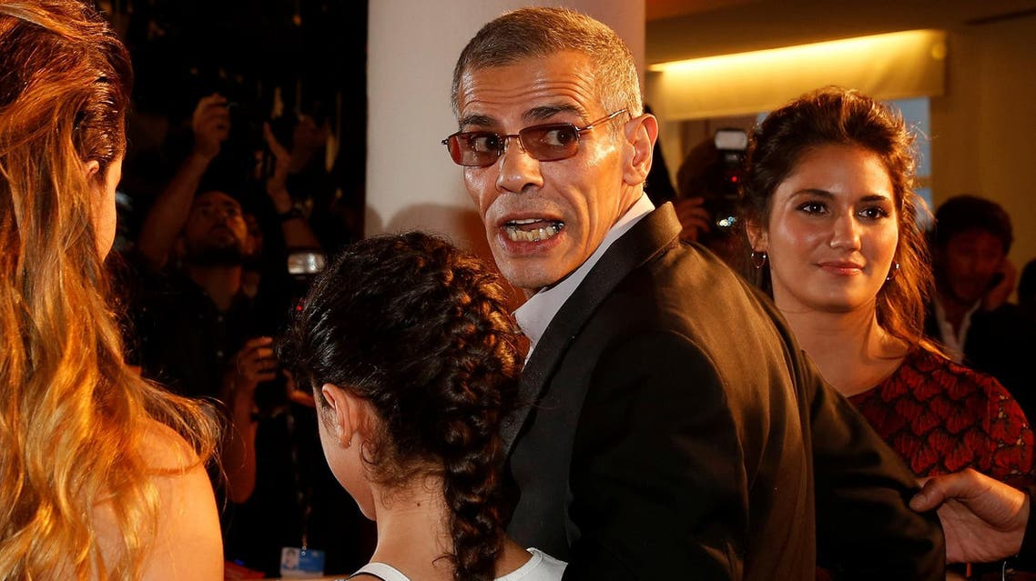 Director Abdellatif Kechiche (2nd to R) poses with actors as they arrive during the red carpet event for the movie on September 7, 2017. (Reuters)