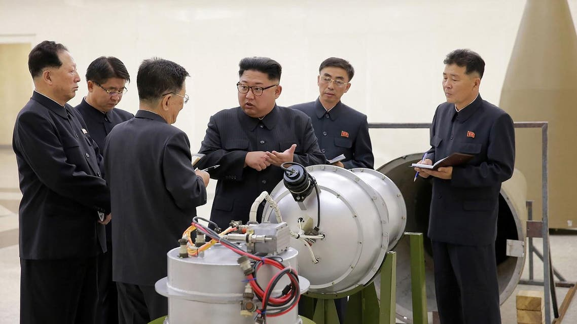 North Korean leader Kim Jong Un provides guidance with Ri Hong Sop (2nd L) and Hong Sung Mu (R) on a nuclear weapons program. (AFP)