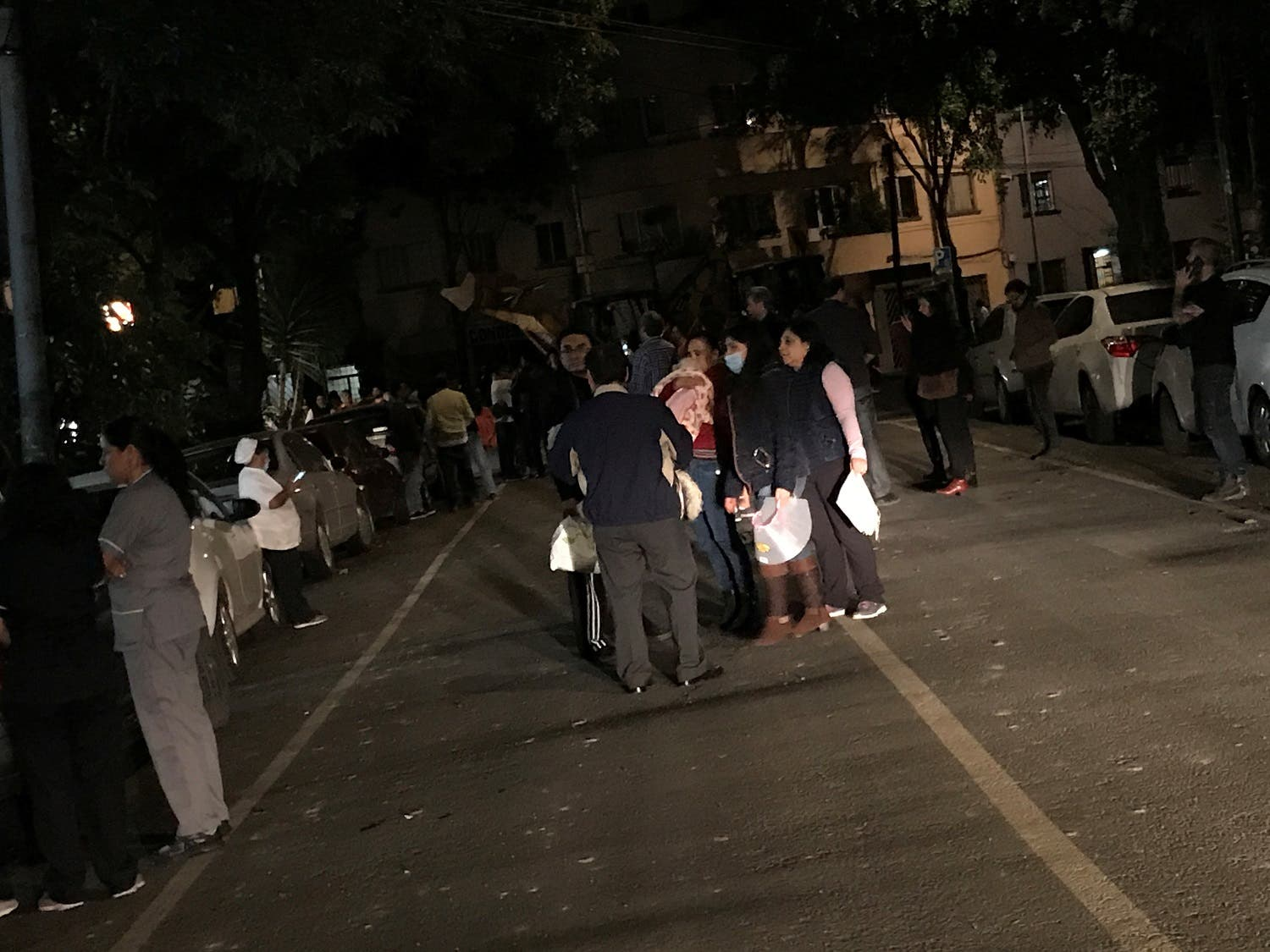 Residents rushed to the streets after an earthquake in Mexico City on Thursday night. (Reuters)