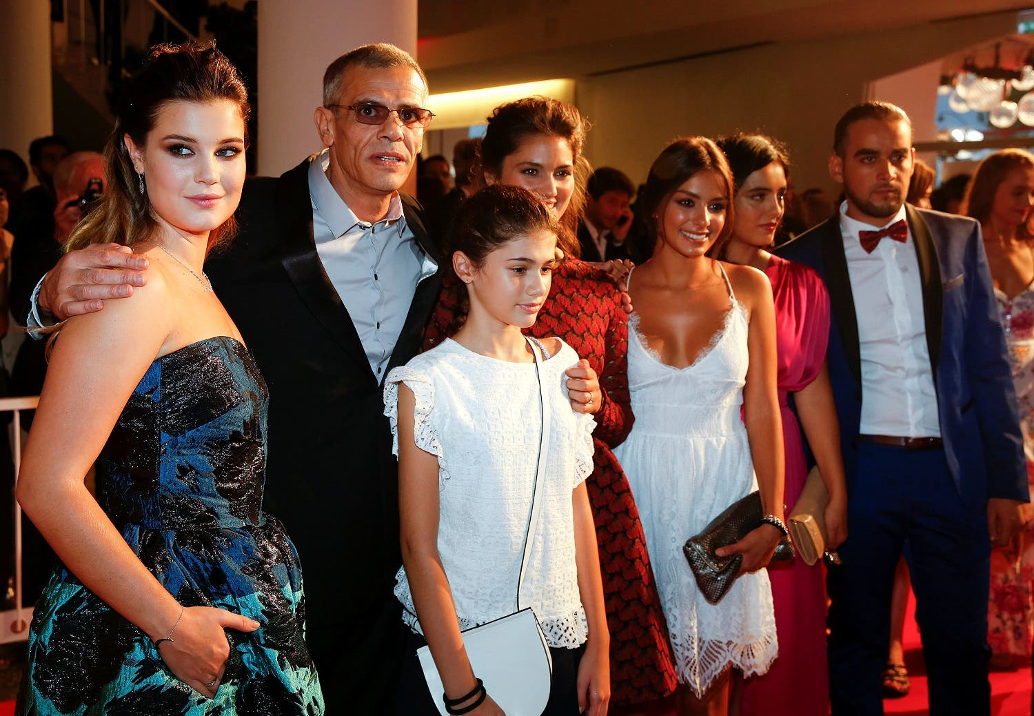 """Director Abdellatif Kechiche poses with actors Alexia Chardard, Ophelie Bau and Melinda Elastfour as they arrive during the red carpet event for the movie """"Mektoub, My Love: Canto Uno"""" at the 74th Venice Film Festival in Venice, Italy, September 7, 2017. (Reuters)"""