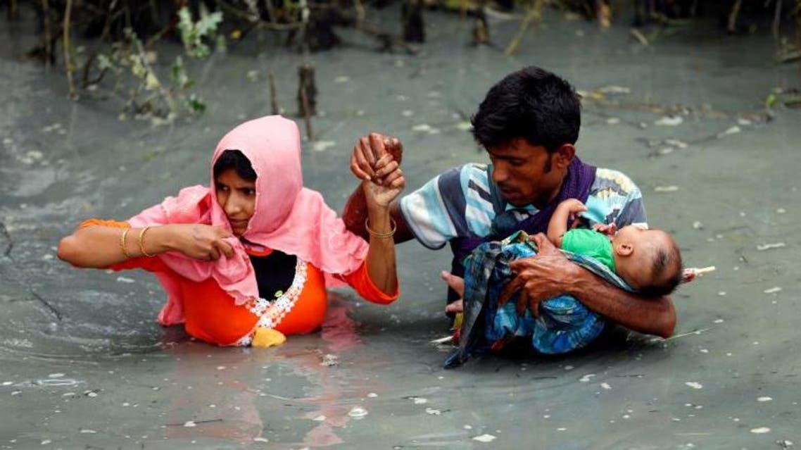 Rohingya Muslims flee Myanmar violence