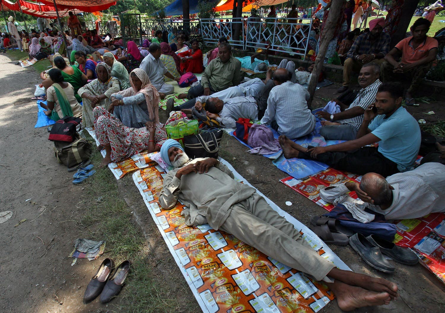 Supporters of Gurmeet Ram Rahim Singh rest as they gather near a stadium in Panchkula in the northern state of Haryana, India, on August 24, 2017. (Reuters)