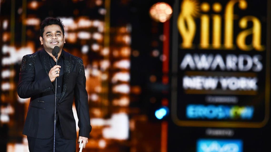 Bollywood music composer/singer AR Rahman accepts an award during the 18th International Indian Film Academy (IIFA) Festival in East Rutherford, New Jersey, on July 15, 2017. (AFP)