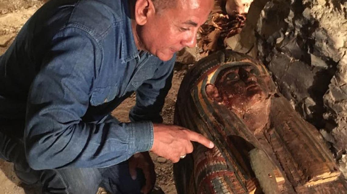 An Egyptian archaeologist looking at a sacrophagus at a newly-uncovered ancient tomb for a goldsmith dedicated to the ancient Egyptian god Amun, in the Draa Abul Naga necropolis on the west bank of the ancient city of Luxor. (AFP)