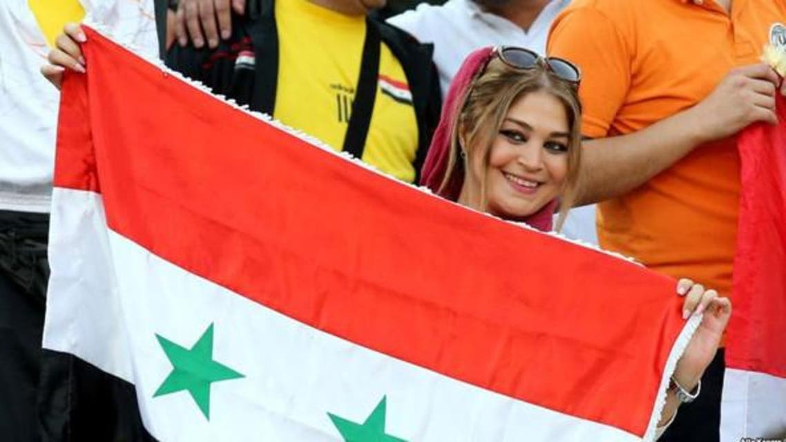 A supporter of Syria's national team attends the FIFA World Cup 2018 qualification football match between Syria and Iran at the Azadi Stadium in Tehran on September 5, 2017. (AFP)