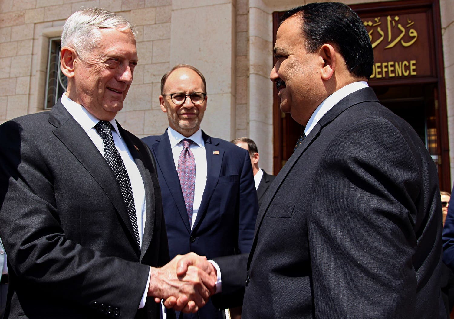 Iraqi Defense Minister Erfan al-Hayali, (right), welcomes US Defense Secretary Jim Mattis (left), and US Ambassador to Iraq Douglas Silliman, to the Ministry of Defense, in Baghdad, on Aug. 22, 2017. (AP)