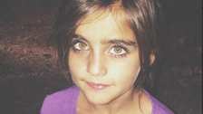 Green-eyed girl selling figs becomes 'face of Kurdish region's poor children'