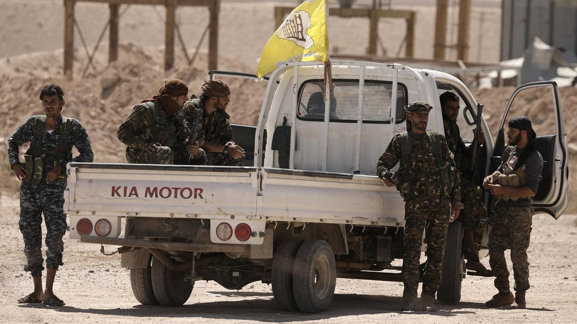 Fighters from Deir al-Zor military council which fights under the Syrian Democratic Forces (SDF) sit on a back of a truck in the village of Abu Fas, Hasaka province, Syria September 9, 2017. REUTERS/Rodi Said
