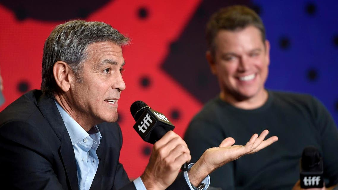 """George Clooney, left, speaks as Matt Damon looks on during a press conference for """"Suburbicon"""" on day 4 of the Toronto International Film Festival at the TIFF Bell Lightbox on Sunday, Sept. 10, 2017, in Toronto. (Photo by Chris Pizzello/Invision/AP)"""