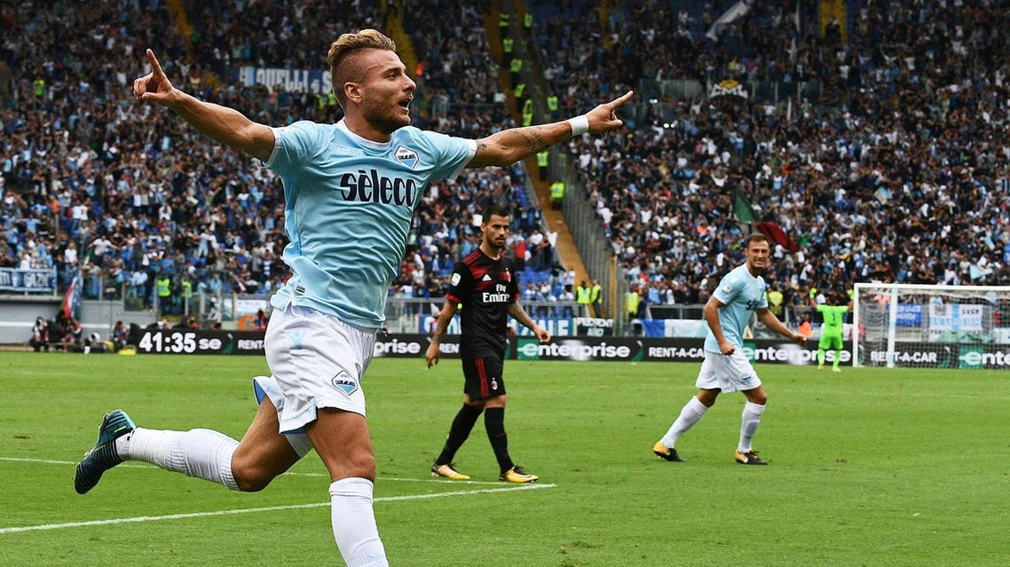 Lazio's forward from Italy Ciro Immobile celebrates after scoring his second goal during the Italian Serie A football match Lazio vs AC Milan on September 10, 2017 at the Olympic stadium in Rome.  Vincenzo PINTO / AFP