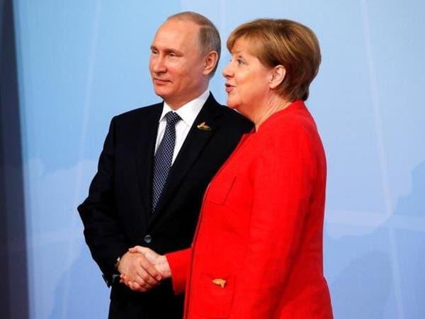 بوتين وميركل يؤكدان أهمية عودة اللاجئين السوريين