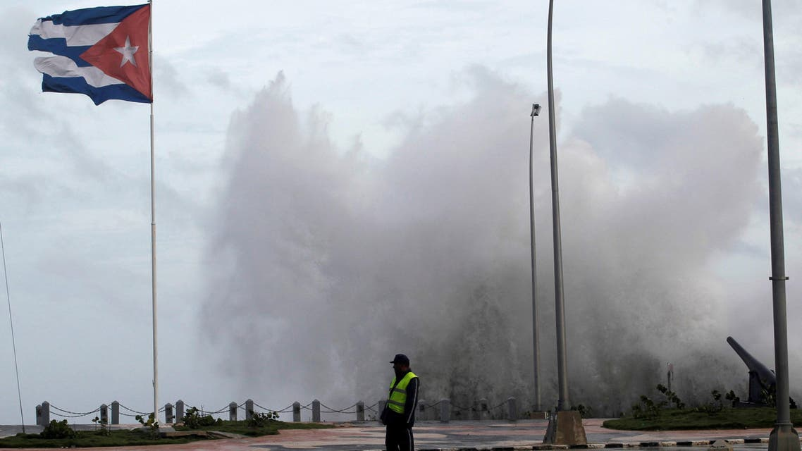 FILE PHOTO: A police officer stands on the seafront boulevard El Malecon ahead of the passing of Hurricane Irma, in Havana, Cuba September 9, 2017. REUTERS/Stringer NO SALES. NO ARCHIVES/File Photo
