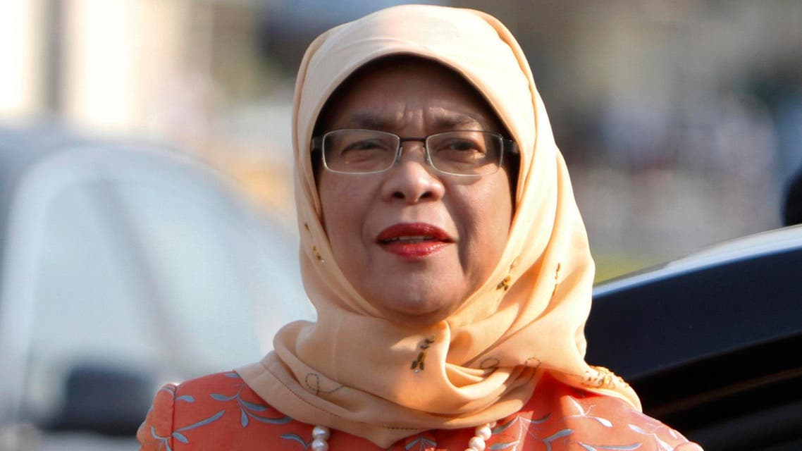 In this Thursday, May 7, 2015, file photo, Halimah Yacob arrives at the Cambodian National Assembly building during a welcome meeting in Phnom Penh, Cambodia. AP