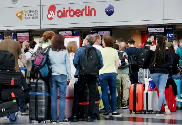 Travellers whose flights have been cancelled by Air Berlin. (AP)