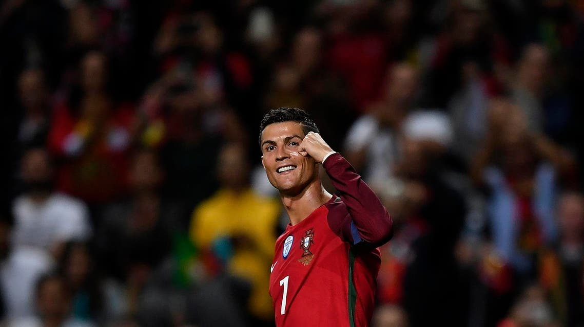 Portugal's forward Cristiano Ronaldo celebrates after scoring a goal during the WC2018 qualifying football match Portugal vs Faroe Islands at the Bessa stadium in Porto on August 31, 2017. (AFP)