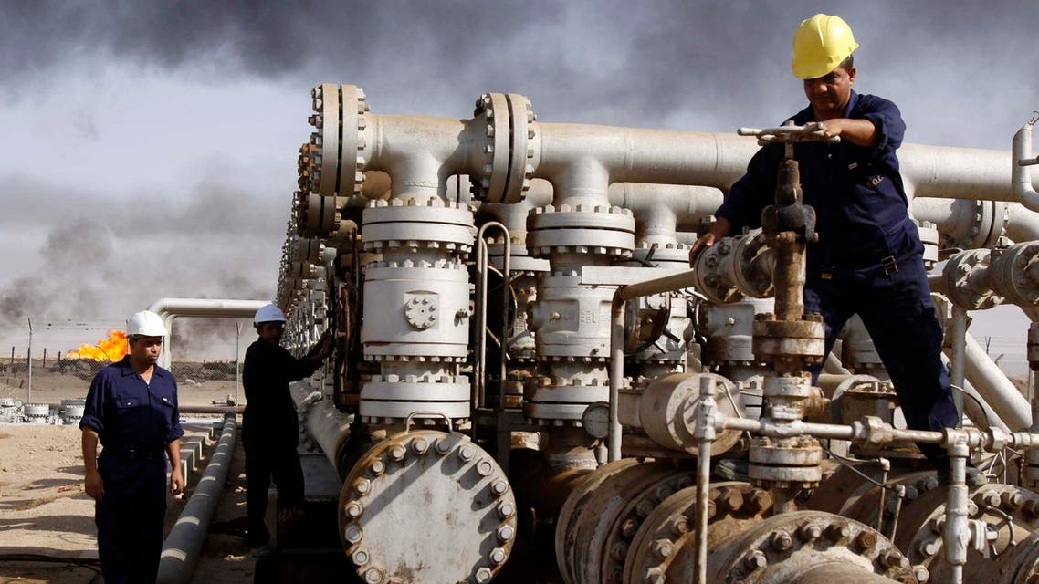 In this Dec. 13, 2009 file photo, Iraqi workers are seen at the Rumaila oil refinery, near the city of Basra, 550 km southeast of Baghdad, Iraq. (AP)