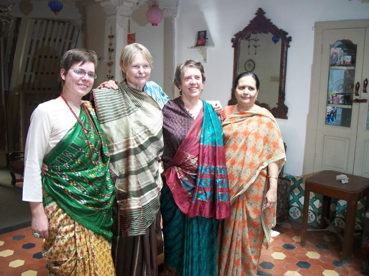Foreign guests learn to wear the Indian sari at Jagdeep Mehta's Heritage House. (Supplied)