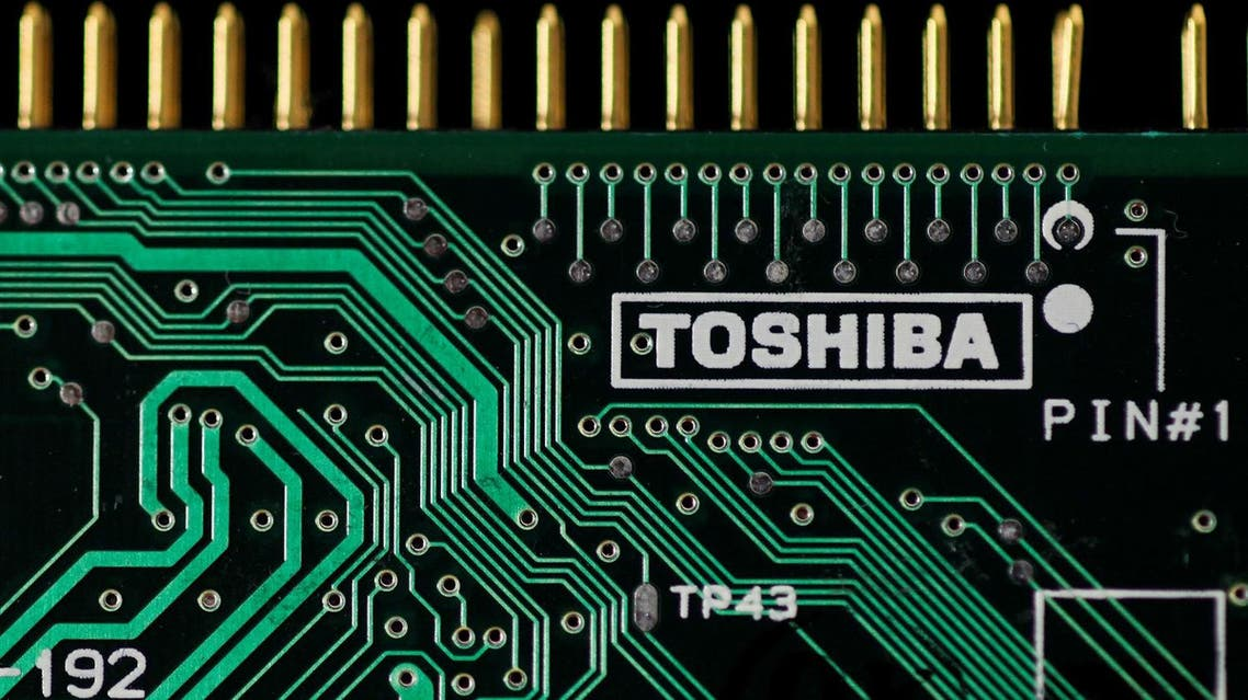 A logo of Toshiba Corp is seen on a printed circuit board in this photo illustration. (Reuters)
