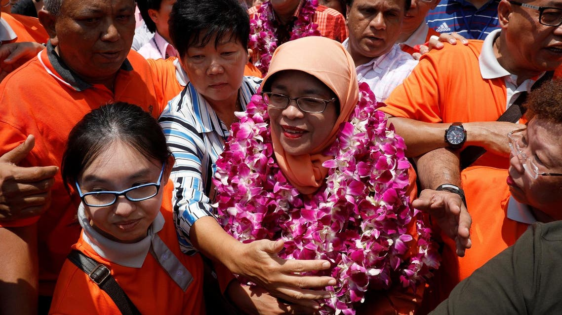 Singapore's President-elect Halimah Yacob greets supporters as she leaves the nomination center in Singapore on September 13, 2017. (Reuters)