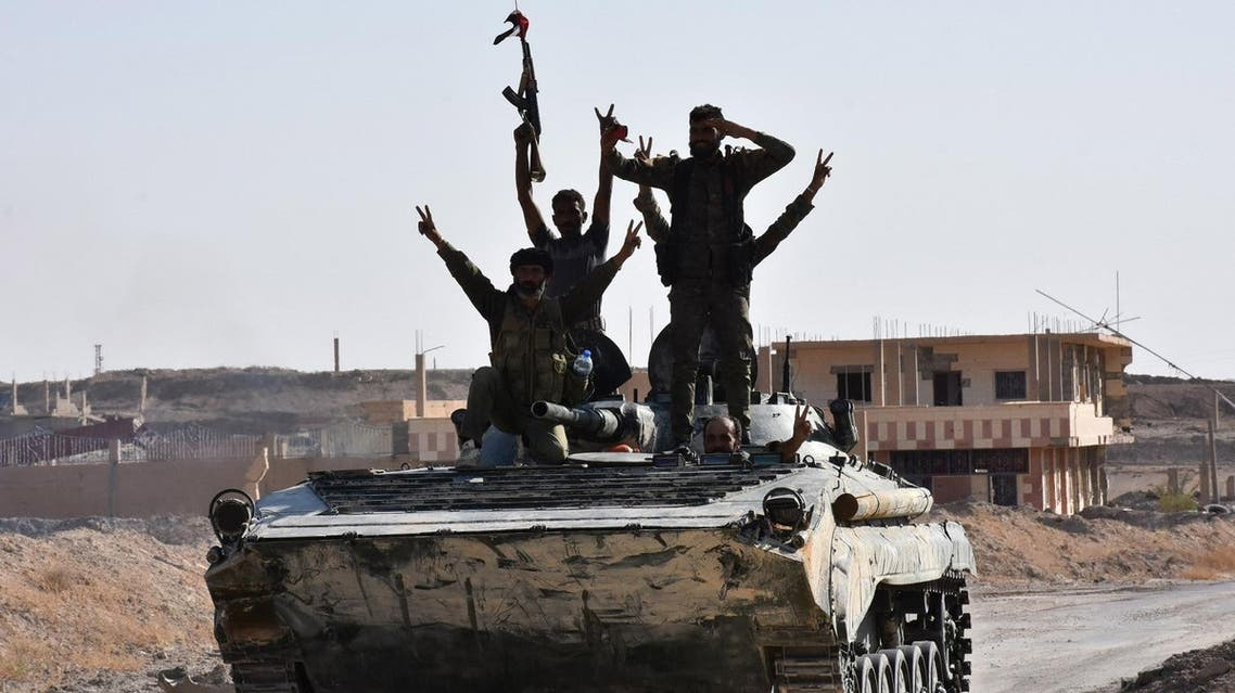 Syrian government forces celebrate in the eastern Syrian city of Deir Ezzor on September 11, 2017 as they continue to press forward with Russian air cover in the offensive against Islamic State group jihadists across the province. Syrian army reinforcements arrived in Deir Ezzor for a new push against the Islamic State group, as a second day of suspected Russian strikes killed 19 civilians in the area. (AFP)