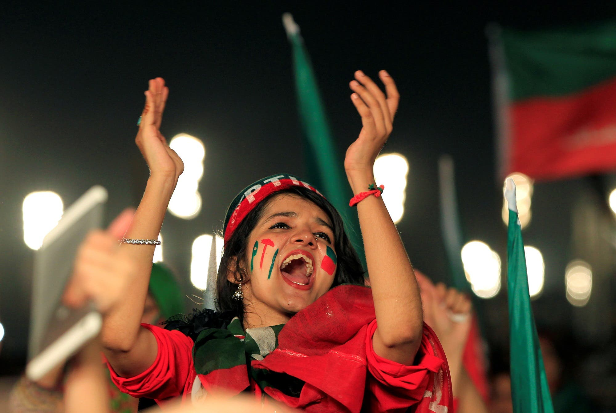 Supporters of Imran Khan cheer to celebrate the Supreme Court decision to oust the Prime Minister Nawaz Sharif during a rally in Islamabad on July 30, 2017. (Reuters)