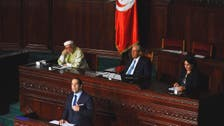 Tunisia pardons thousands with corrupt pasts, amid protest