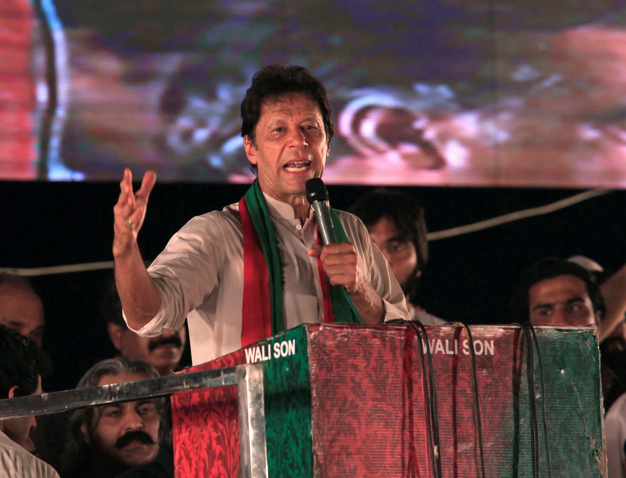 Imran Khan speaks to supporters during a celebration rally after the Supreme Court disqualified Prime Minister Nawaz Sharif in Islamabad, Pakistan, on July 30, 2017. (Reuters)