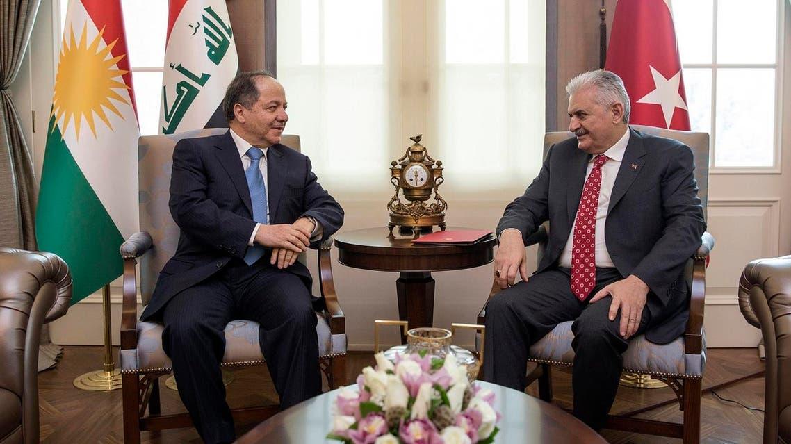 Turkey's Prime Minister Binali Yildirim (right), speaks with Iraqi Kurdish leader Massoud Barzani, in Ankara, Turkey, Monday, Feb. 27, 2017. (AP)
