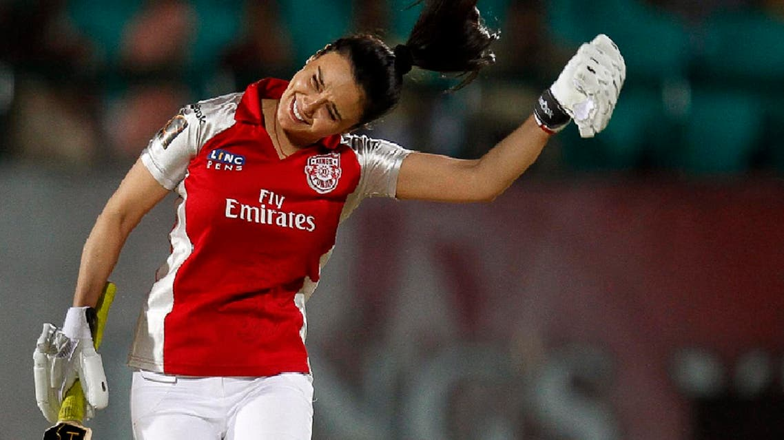 Preity Zinta, owner of Kings XI Punjab, celebrates after hitting a four during an exhibition match between the management teams of Kings XI Punjab and Deccan Chargers in Dharmsala, India, on May 21, 2011. (AP)