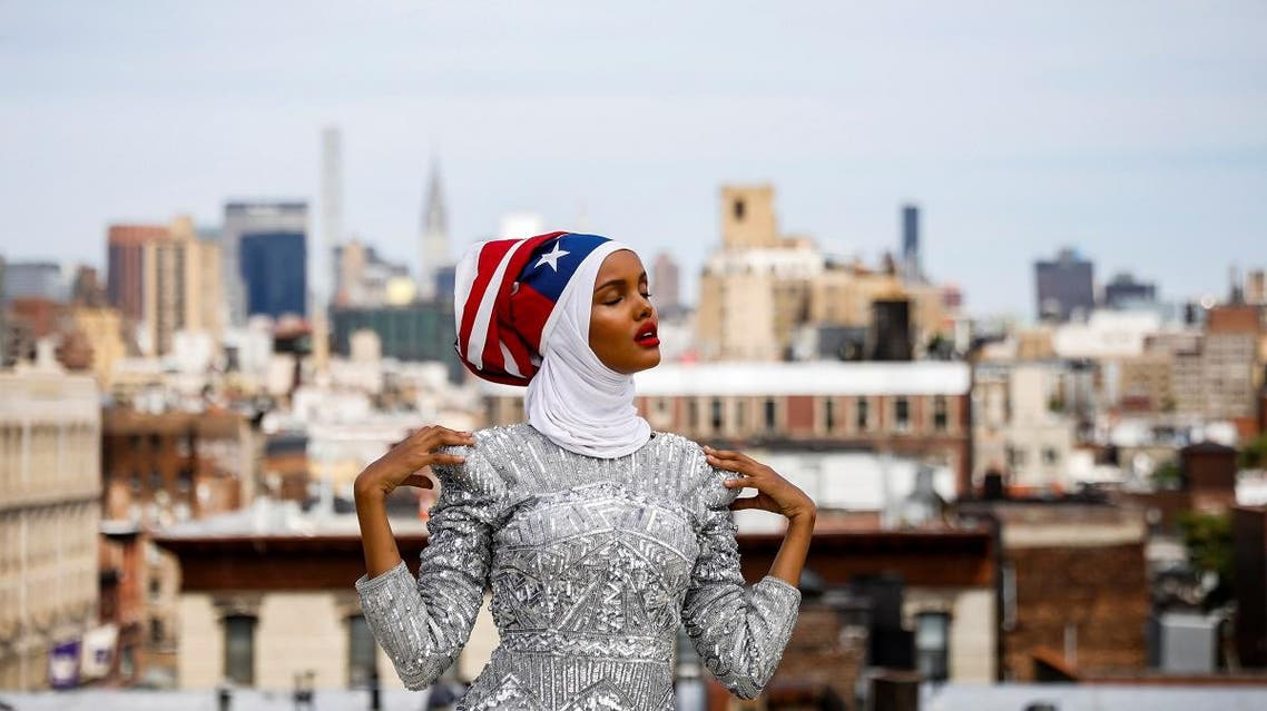 Fashion model and former refugee Halima Aden, who is breaking boundaries as the first hijab wearing model gracing magazine covers and walking in high profile runway shows poses during a shoot at a studio in New York City. (Reuters)