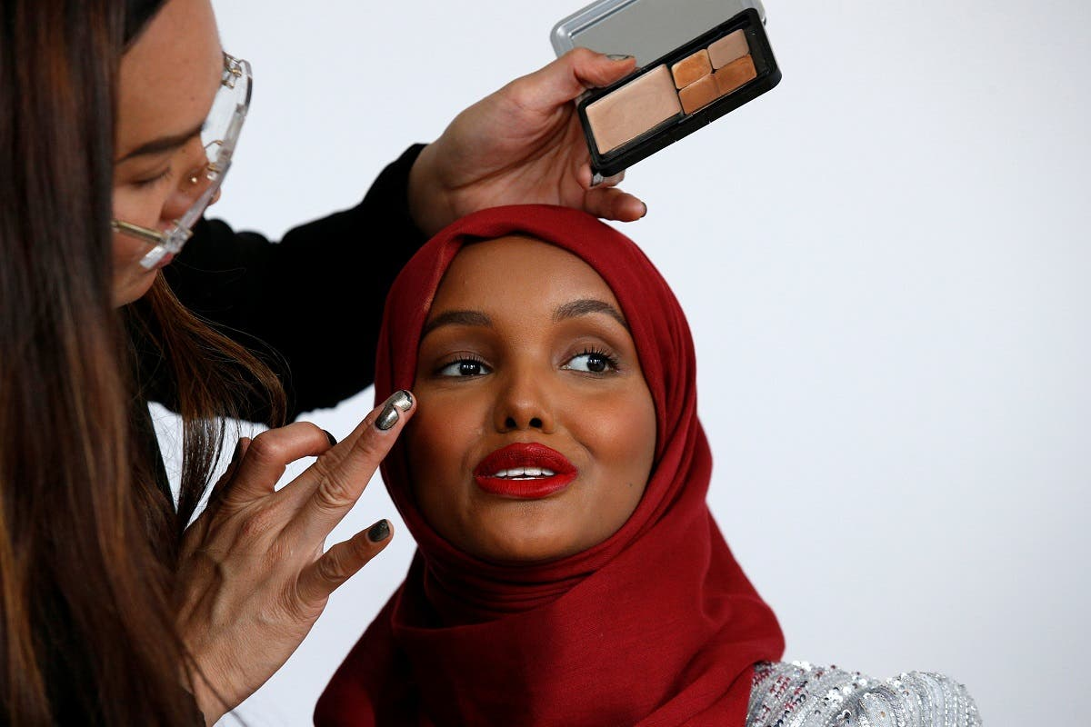 Fashion model and former refugee Halima Aden, who is breaking boundaries as the first hijab wearing model gracing magazine covers and walking in high profile runway shows has her makeup applied during a shoot at a studio in New York. (Reuters)
