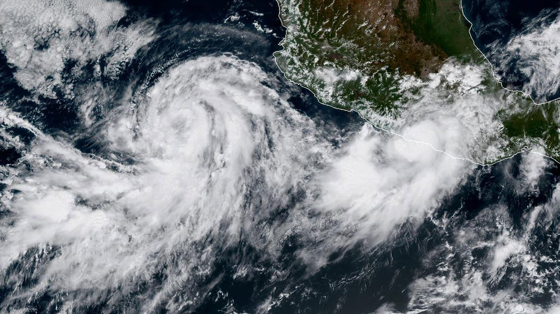 This satellite image obtained from the National Oceanic and Atmospheric Administration (NOAA) shows Hurricane Max (R) and Tropical Storm Norma on September 14, 2017. (AFP)